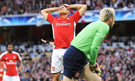 Kieran Gibbs holds his head in his hands