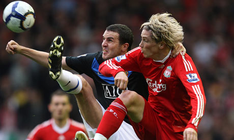 Torres and O'Shea battle for the ball