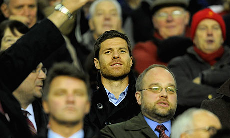 Xabi Alonso watches from the Anfield stands