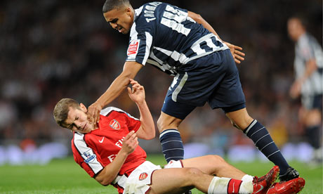 West Bromwich Albion's Jerome Thomas shoves Arsenal's Jack Wilshere in the face