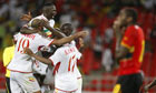 Mali's players celebrate after coming from 4-0 down to draw with Angola