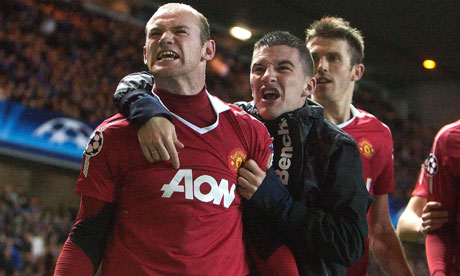 A Manchester United fan celebrates with Wayne Rooney