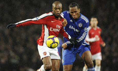 Didier Drogba and William Gallas battle for the ball