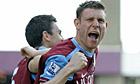 James Milner celebrates his penalty with Stewart Downing