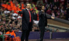 Rafael Benitez stands alongside Atletico Madrid's manager Enrique Sanchez Flores