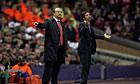 Rafael Benitez stands alongside Atletico Madrid's manager Enrique Sanchez Flores