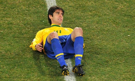 Kaká lies on the turf after a mixed performance against Ivory Coast