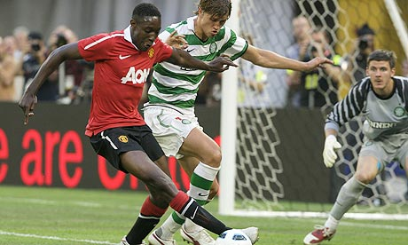 Danny Welbeck, left, clashes with James Forrest during Manchester United's 3-1 win over Celtic