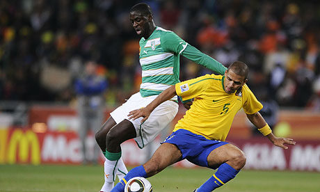 Yaya Touré, left, tussles with Felipo Melo during the Ivory Coast's defeat to Brazil