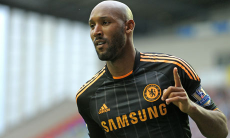 Nicolas Anelka celebrates after scoring the first of his two goals against Wigan.