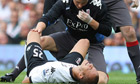 Fulham's Bobby Zamora receives medical attention after breaking his ankle against Wolves.
