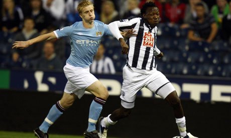 West Brom's Somen Tchoyi, right, races past Manchester City's Ben Mee at the Hawthorns.