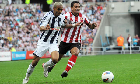 West Bromwich Albion's Peter Odemwingie, left, and Kieran Richardson battle for the ball