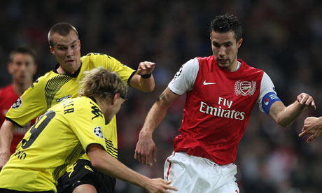 Arsenal's Robin van Persie is surrounded by Borussia Dortmund defenders