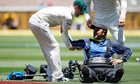 Australia's captain Michael Clarke assists Joe Previtera at the MCG