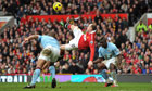 Wayne Rooney scores Manchester United's second against Manchester City at Old Trafford.