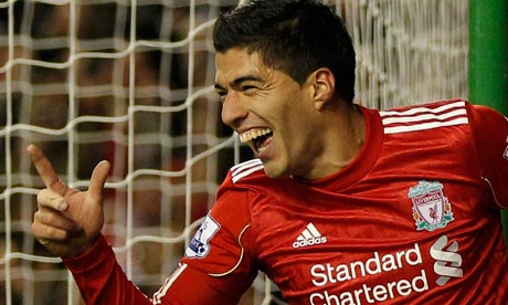 Liverpool's new signing, Luis Suarez, celebrates scoring against Stoke City on his debut