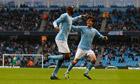 Patrick Vieira celebrates with David Silva after scoring