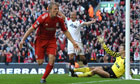Liverpool's Dirk Kuyt celebrates scoring his third goal against Manchester United at Anfield