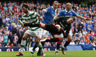 Georgios Samaras collides with David Weir as the goalkeeper Allan McGregor holds the ball tight