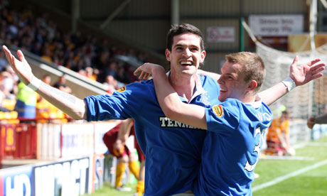 Kyle Lafferty celebrates scoring the opening goal as Rangers routed Motherwell