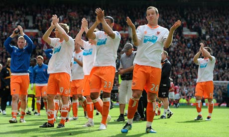 Blackpool's players applaud their fans