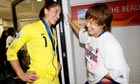 The USA goalkeeper Hope Solo talks with Japan's Aya Miyama