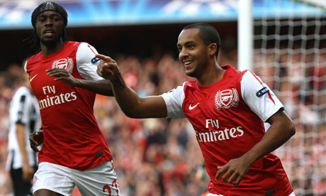 Arsenal's Theo Walcott celebrates with Gervinho