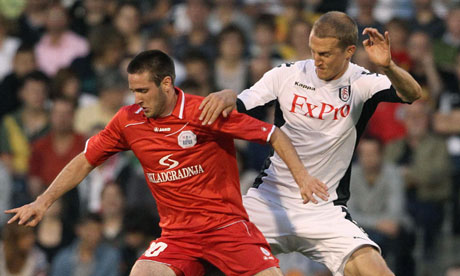 Fulham's Brede Hangeland, right, tangles with RNK Split's Duje Cop