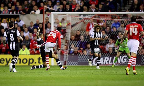 Robbie Findley of Nottingham Forest scores against Newcastle