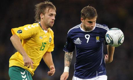 Scotland's David Goodwillie challenges Lithuania's Arunas Klimavicius