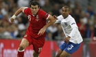 Gareth Bale, left, goes past England full-back Ashley Cole during his side's defeat at Wembley