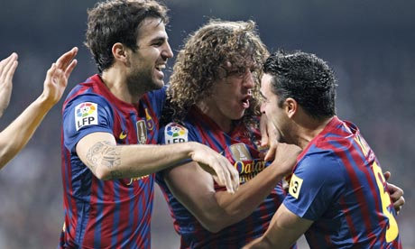 Barcelona's captain Carlos Puyol, centre, celebrates after scoring