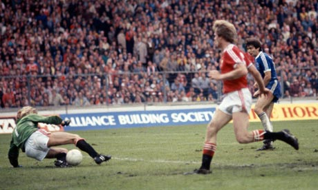 Gary Bailey saves from Gordon Smith in the 1983 FA Cup final