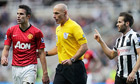 Referee, Howard Webb (C) intervenes betw