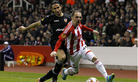 Valencia's goalscorer Mehmet Topal, left, battles for the ball with Stoke's Matthew Etherington