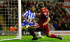 Liam Bridcutt scores an own goal for Brighton against Liverpool