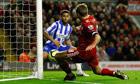 Liam Bridcutt scores an own goal for Brighton against Liverpool