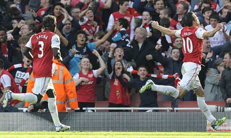 Robin van Persie celebrates scoring Arsenal's second goal against Tottenham