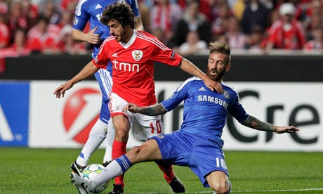 Benfica's Pablo Aimar is dispossessed by Raul Meireles