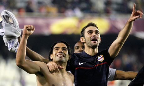 Atlético Madrid's Radamel Falcao, left, and Adrián López celebrate