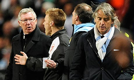 Manchester City manager Roberto Mancini, right, still insists United are favourites for the title