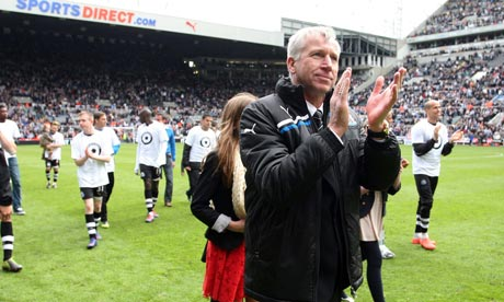 The Newcastle manager, Alan Pardew, applauds the fans