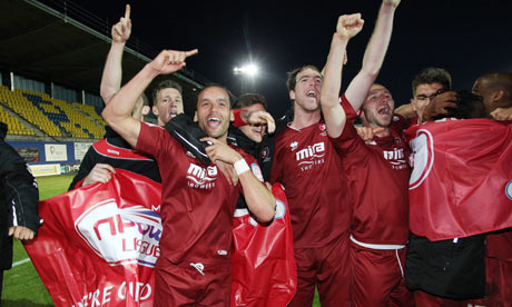 Cheltenham Town's players celebrate reaching the League Two play-off final