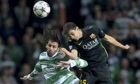 Celtic's Giorgios Samaras vies for the ball with Marc Bartra of Barcelona in the Champions League