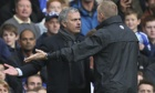 José Mourinho, left, makes his feelings known to fourth official Trevor Kettle