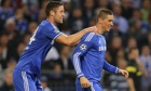 Chelsea's Gary Cahill, left, celebrates with Fernando Torres after the latter scored against Schalke