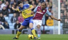 Gareth Barry, left, tangles with Aston Villa's Gabriel Agbonlahor during Everton's 2-0 victory