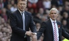 Stoke City manager Mark Hughes, right, is unconvinced Manchester United have turned the corner