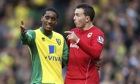 Norwich City's Leroy Fer, left, Jordon Mutch of Cardiff City discuss the home side's disallowed goal